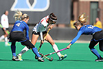 DURHAM, NC - NOVEMBER 11: Miami's Estel Roig (ESP) (center) is defended by Duke's Ashley Kristen (CAN) (4) and Margaux Paolino (12). The Duke University Blue Devils hosted the Miami University (Ohio) Redhawks on November 11, 2017 at Jack Katz Stadium in Durham, NC in an NCAA Division I Field Hockey Tournament First Round game. Duke won the game 4-2.