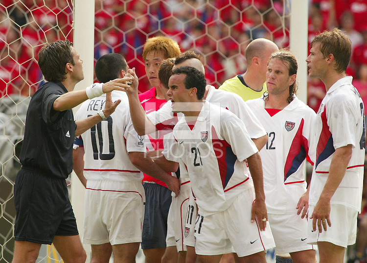 Landon Donovan argues a penalty kick call with the referee. The USA tied South Korea, 1-1, during the FIFA World Cup 2002 in Daegu, Korea.