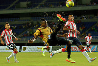 PEREIRA -COLOMBIA-02-08-2014. Michael Balanta de Aguilas Doradas en acción durante juego con Atletico Junior por la fecha 3 de la Liga Postobón II 2014 jugado en el estadio Hernán Ramírez Villegas de Pereira./ AMichael Balanta player of Aguilas Doradas in action during the match against Atletico Junior for the third date of the Postobon Cup 2014 played at Hernan Ramirez Villegas of Pereira city.  Photo:VizzorImage/ CONT