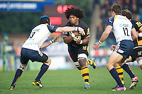 Ashley Johnson of London Wasps (right) is tackled by Alex Grove of Worcester Warriors during the LV= Cup second round match between London Wasps and Worcester Warriors at Adams Park on Sunday 18th November 2012 (Photo by Rob Munro)