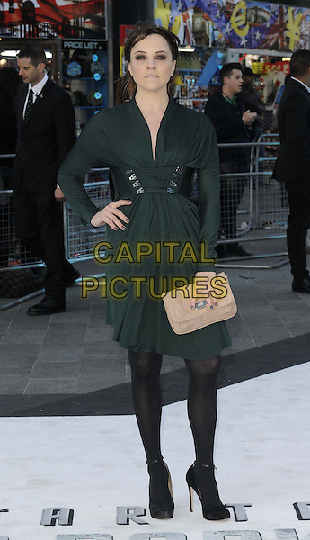 Ania Sowinski.attended the 'Star Trek: Into Darkness 3D' UK film premiere, Empire cinema, Leicester Square, London, England, UK, .2nd May, 2013..full length green dress buckle belt hand on hip long sleeve black tights  beige clutch bag .CAP/CAN.©Can Nguyen/Capital Pictures.