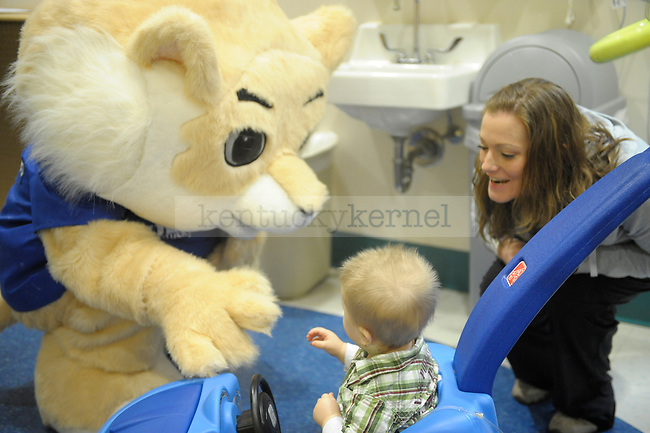 "Roman Kiteck, 11 months, and his mother are greeted by UK's  ""Stich"" wildcat during the Dream Factory Valentine's Party at Kentucky Children's Hospital in Lexington, Ky., on 2/14/12. Photo by Mike Weaver 
