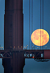 Clear skies made way for a setting full moon behind the Golden Gate Bridge as the city worked it's way out of the fog and haze for pleasant temperatures for the day.