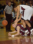 TORRINGTON, CT- 06 JANUARY 2009 --010609JS04-Naugatuck's Anthony Mariano (22) and Torrington's Jordan Williams (20) battle for a loose ball during their game Tuesday at Torrington. <br /> Jim Shannon / Republican-American