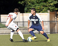 University of Rhode Island (URI) defender Alan Hernandez (6) dribbles. Boston College defeated University of Rhode Island, 4-2, at Newton Campus Field, September 25, 2012.