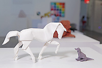 Surface to Structure origami exhibition at Cooper Union, New York. Gallery view. Horse (2000) and Dog (1975) designed and folded by David Brill.