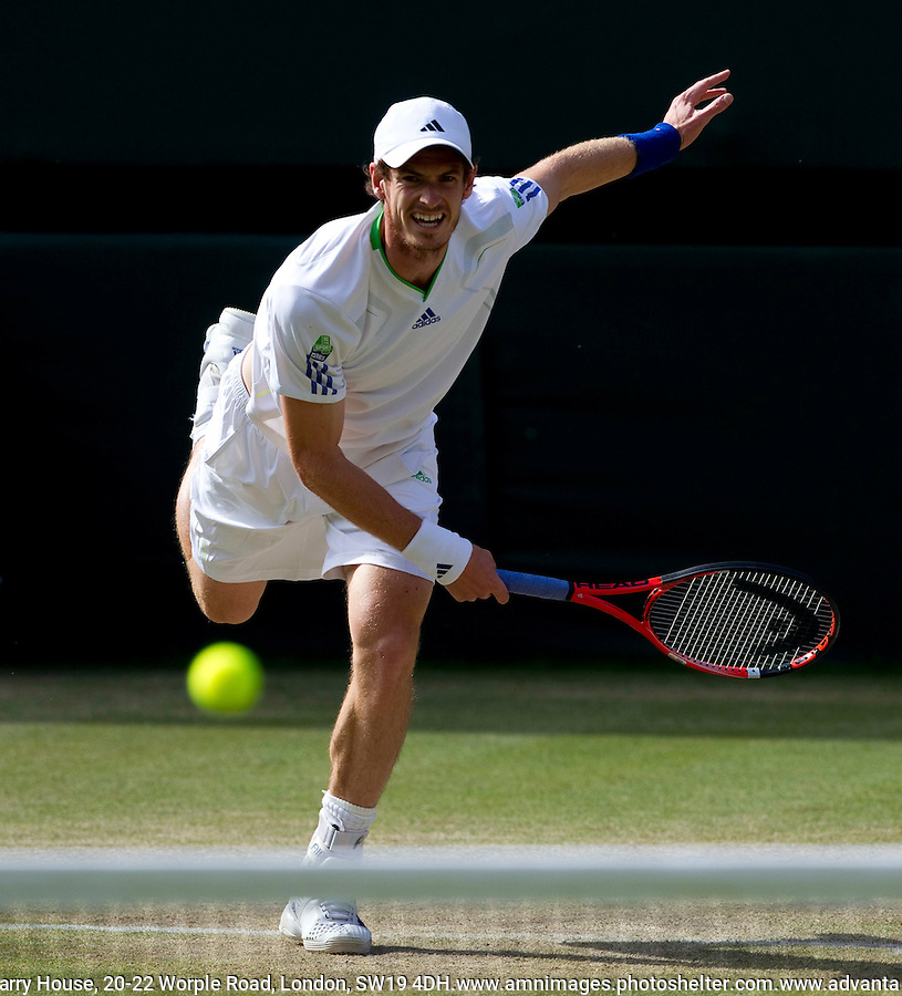 ANDY MURRAY (GBR) (4) against FELICIANO LOPEZ (ESP) in the Quarter Finals of the Gentlemen's SIngles. Andy Murray beat Feliciano Lopez 6-3 6-4 6-4..Tennis - Grand Slam - Wimbledon - AELTC - London- Day 09 - Wed June 29th  2011..© AMN Images, Barry House, 20-22 Worple Road, London, SW19 4DH, UK..+44 208 947 0100.www.amnimages.photoshelter.com.www.advantagemedianetwork.com.