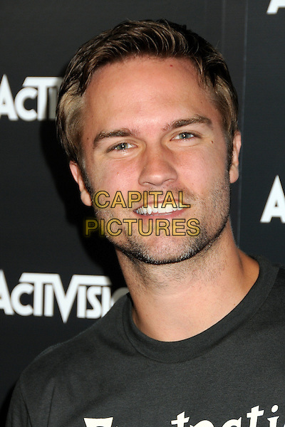 SCOTT PORTER .Activision E3 2010 Preview Event held at the Staples Center, Los Angeles, California, USA..June 14th, 2010.headshot portrait black stubble facial hair .CAP/ADM/BP.©Byron Purvis/AdMedia/Capital Pictures.