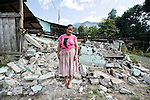Odilia Isidra Bonilla, 52, of Villa Hermosa, San Marcos stands in front of the rubble of her destroyed kitchen by a 7.4 earthquake struck Guatemala Wednesday Nov. 7.