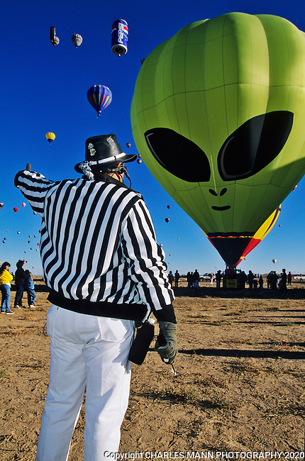 A Zebra or balloon event official gives the signal to OK the launch of a  UFO ET balloon at the Albquuerque International Hot Air Balloon Fiesta