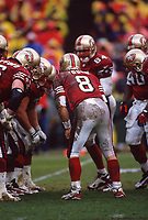 SAN FRANCISCO, CA:  Quarterback Steve Young of the San Francisco 49ers stands in the huddle in the rain during the NFC playoff game against the Philadelphia Eagles at Candlestick Park in San Francisco, California on December 29, 1996. (Photo by Brad Mangin)