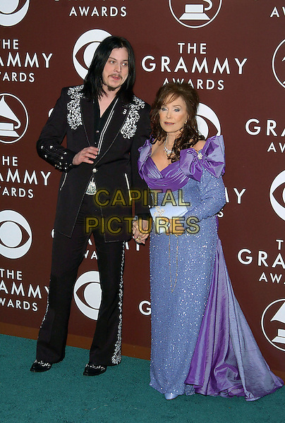 JACK WHITE & LORETTA LYNN.47th Annual Grammy Awards - Arrivals. Los Angeles, California .February 13th, 2005.Photo Credit: Jacqui Wong/AdMedia.full length holding hands black suit pale purple dress bows ribbons sequins.www.capitalpictures.com.sales@capitalpictures.com.© Capital Pictures.