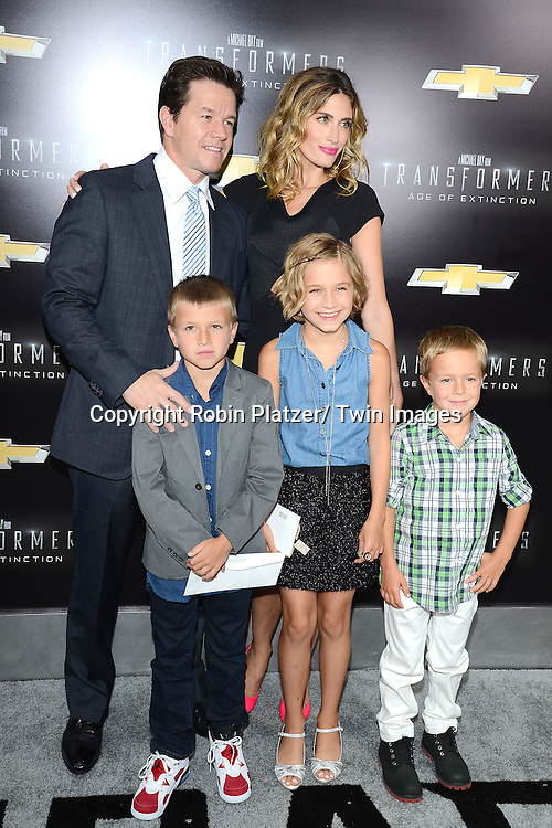 "Mark Wahlberg and wife Rhea Durham and children attend the US Premiere of ""Transformers: Age of Extinction"" on June 25, 2014 at The Ziegfeld Theatre in New York City, New York, USA."