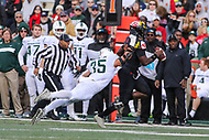 College Park, MD - November 3, 2018:  Michigan State Spartans linebacker Joe Bachie (35) dives for Maryland Terrapins quarterback Kasim Hill (11) during the game between Michigan St. and Maryland at  Capital One Field at Maryland Stadium in College Park, MD.  (Photo by Elliott Brown/Media Images International)