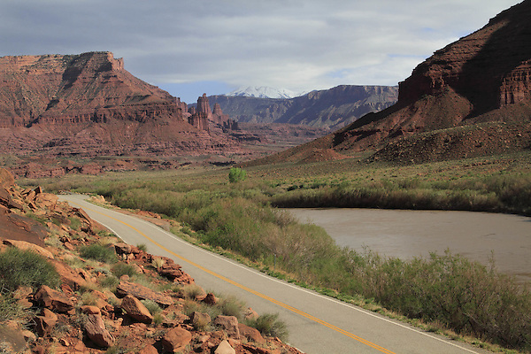 Fisher Towers and the La Sal Mountains along the Colorado River going towards Moab, Utah, USA.