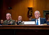 """United States Secretary of Defense James N. Mattis, right, and the Chairman of the Joint Chiefs of Staff, US Marine Corps General Joseph F. Dunford, Jr., left, testify at a US Senate Committee on Appropriations Subcommittee on Defense hearing entitled """"A Review of the Budget & Readiness of the Department of Defense"""" on Capitol Hill in Washington, DC on Wednesday, March 22, 2017.<br /> Credit: Ron Sachs / CNP"""