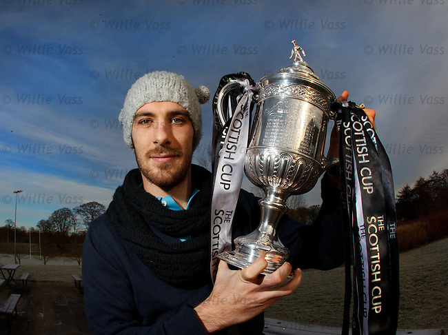 Manuel Pascali with the Scottish Cup and a lucky hat he found on a bus