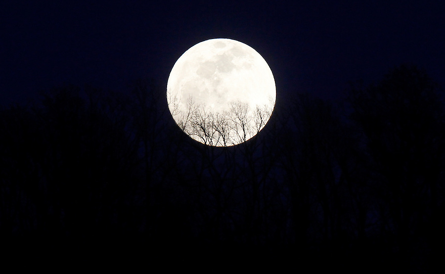 The full moon over Carters Mountain in Charlottesville, Va. Photo/Andrew Shurtleff