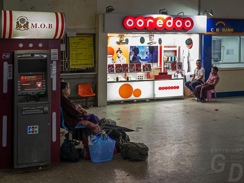 Life at the Yangon Railway Station, Yangon, Myanmar, Burma Cell Phone shops and ATM machines are now a common in Yangon and many other places in Myanmar