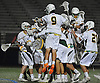 Ward Melville teammates celebrate after their 16-6 win over Lakeland-Panas in the NYSPHSAA varsity boys lacrosse Class A state semifinals at Hofstra University on Wednesday, June 8, 2016