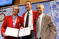 Hank Steinbrecher, inductee Thomas Dooley, and US Soccer President Sunil Gulati pose for photos during the induction ceremony for the National Soccer Hall of Fame at the New Meadowlands Stadium in East Rutherford, NJ, on August 10, 2010.