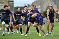 Jack Hughes, of visiting rugby league team Wigan Warriors, is tackled. Bath Rugby pre-season training session on August 18, 2014 at Farleigh House in Bath, England. Photo by: Patrick Khachfe/Onside Images