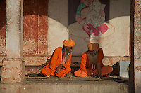 Priest reading the News paper Varanasi Ganges India