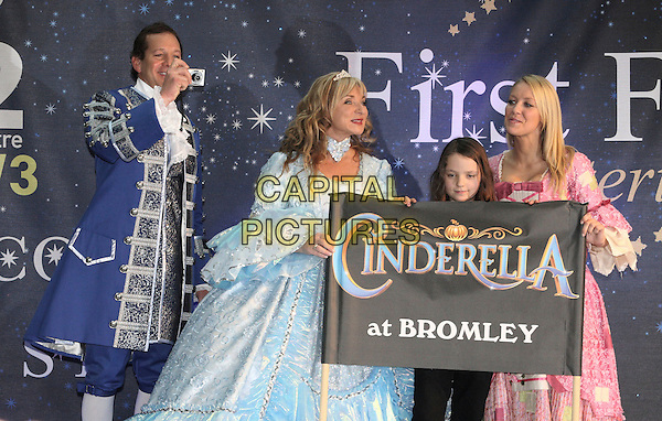 HELEN LEDERER, STEVE GUTTENBERG  & LAURA HAMILTON .Photocall to launch the celebrity Pantomime productions from First Family Entertainment held at the O2 Centre NW3, London, England, .November 19th 2008..panto half length costume outfit camera taking photo pink tiara dress white crown  blue ruffle scar collar jacket shirt holding sign banner Cinderella .CAP/JIL.©Jill Mayhew/Capital Pictures