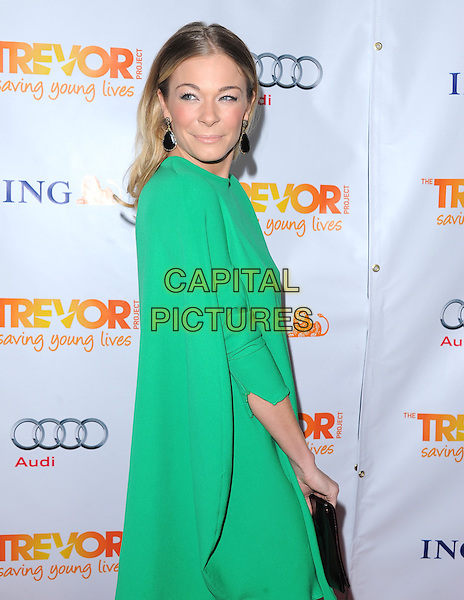 LeAnn Rimes.Trevor Live at The Hollywood Palladium in Hollywood, California, USA..December 4th, 2011  .half length dress green clutch bag side black.CAP/RKE/DVS.©DVS/RockinExposures/Capital Pictures.