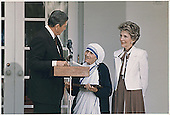 U.S. President Ronald Reagan and First Lady Nancy Reagan present Mother Teresa with the Medal of Freedom at a White House Ceremony on June 20, 1985.<br /> Credit: White House via CNP
