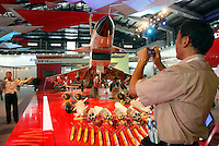 A man takes a picture of a model of Chinese made J-10 Interceptor at the 2008 China International Aerospace and Aviation Exhibition in Zhuhai, China..