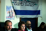 Israeli parliament member Avigdor Lieberman, who heads the ultra-nationalist Yisrael Beiteinu faction, left, speaks during a meeting at his party's offices in Jerusalem, Tuesday, March 17, 2009. On Monday, Benjamin Netanyahu's Likud party initialed a coalition agreement with Yisrael Beiteinu faction, a tentative step that leaves open the possibility of changes if other parties join. Lieberman, who heads the party, has drawn accusations of racism for a plan that would require Arab citizens of Israel to sign loyalty oaths or lose their citizenship. The coalition agreement would see Lieberman become foreign minister. Photo by: Daniel Bar-On/JINI...