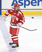David Warsofsky (BU - 5) juggles the puck at the end of warmups. - The Boston College Eagles defeated the visiting Boston University Terriers 5-2 on Saturday, December 4, 2010, at Conte Forum in Chestnut Hill, Massachusetts.