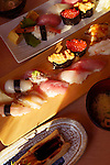 Artistic closeup of sushi plates at a Japanese restaurant. Tokyo, Japan.