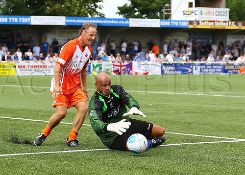 June 17th 2017, Gander Green Lane, Sutton, England; Football Charity Match; Chelsea Legends versus Rangers Legends; Chelsea Keeper Tony Warner gathers the ball as  Rangers Paul Walsh looks to challenge