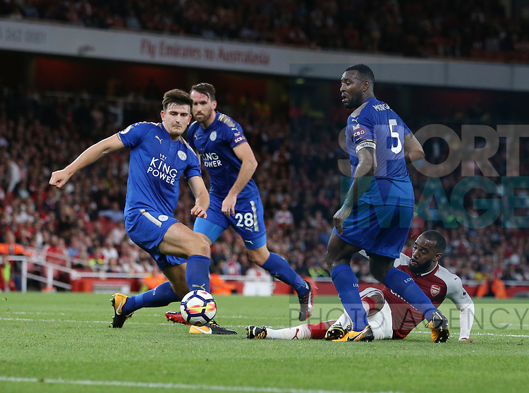 Arsenal's Alexandre Lacazette tussles with Leicester's Harry Maguire and Wes Morgan during the premier league match at the Emirates Stadium, London. Picture date 11th August 2017. Picture credit should read: David Klein/Sportimage