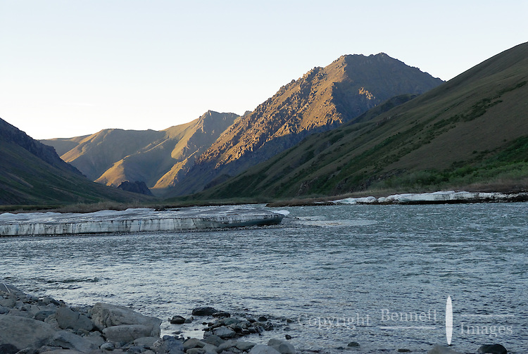 The sun touches distant peaks after midnight the day before summer solstice along the Kongakut River, in Alaska's Arctic National Wildlife Refuge.