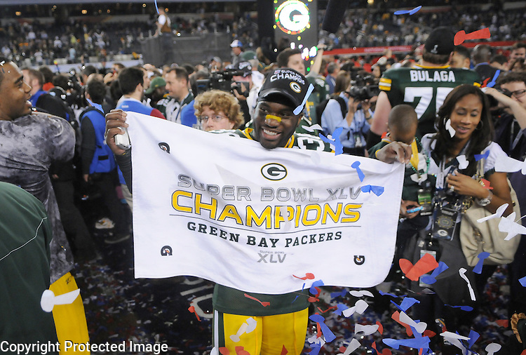 Green Bay Packers safety Nick Collins holds up a championship towel after the Packers defeated the Pittsburgh Steelers in Super Bowl XLV at Cowboys Stadium in Arlington, Texas on Feb. 6, 2011.