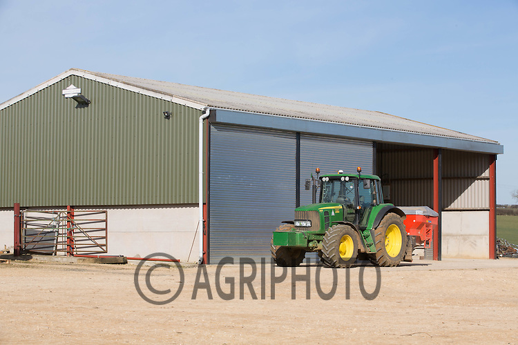 John Deere tractor parked outside of a modern farm building <br /> Picture Tim Scrivener 07850 303986