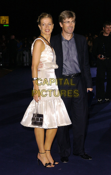 LADY HELEN & TIM TAYLOR.At the Giorgio Armani RED One Night Only .Fashion & Music Party, Earls Court, .London, England, September 21st 2006..full length white dress black strappy sandals shoes bag.Ref: CAN.www.capitalpictures.com.sales@capitalpictures.com.©Can Nguyen/Capital Pictures