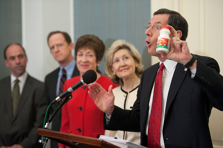"UNITED STATES - JULY 14: Former Congressional Budget Office Director Douglas Hotlz-Eakin, president of the American Action Forum, Patrick Toomey, R-Pa., Susan Collins, R-Maine, Kay Bailey Hutchison, R-Texas and John Barrasso, R-Wyo., during a news conference on ""Republican efforts to cut Washington's red tape."" Barrasso is holding a bottle of milk and blasted the administration for eliminating only one rule. That rule, he said, effectively considered spilled milk an oil spill. ""That's the best this administration can do,"" he said, holding up an individual bottle of milk. Instead of cutting rules, he said, agencies are adding them at a record pace. ""I believe a significant amount of it has to do with regulations coming out of Washington and this administration is making it worse."".Location: S-120, U.S. Capitol (Photo By Douglas Graham/Roll Call)"