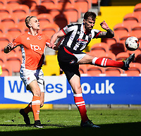 Blackpool's Brad Potts competes with Grimsby Town's Andrew Boyce<br /> <br /> Photographer Richard Martin-Roberts/CameraSport<br /> <br /> The EFL Sky Bet League Two - Blackpool v Grimsby Town - Saturday 8th April 2017 - Bloomfield Road - Blackpool<br /> <br /> World Copyright &copy; 2017 CameraSport. All rights reserved. 43 Linden Ave. Countesthorpe. Leicester. England. LE8 5PG - Tel: +44 (0) 116 277 4147 - admin@camerasport.com - www.camerasport.com