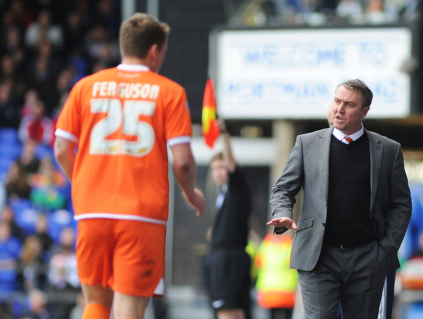 Blackpool Manager Lee Clark gestures his team to slow things down as David Ferguson prepares to take a throw-in<br /> <br /> Photographer Kevin Barnes/CameraSport<br /> <br /> Football - The Football League Sky Bet Championship - Ipswich Town v  Blackpool - Saturday 11th April 2015 - Portman Road - Ipswich<br /> <br /> &copy; CameraSport - 43 Linden Ave. Countesthorpe. Leicester. England. LE8 5PG - Tel: +44 (0) 116 277 4147 - admin@camerasport.com - www.camerasport.com