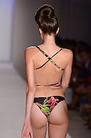 Anna Cleveland walks runway at A.Z Araujo Swimwear Show during Mercedes Benz IMG Fashion Swim Week 2013 at The Raleigh Hotel, Miami Beach, FL on July 23, 2012