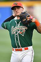First baseman Branden Berry (35) of the Greensboro Grasshoppers warms up before a game against the Greenville Drive on Tuesday, April 25, 2017, at Fluor Field at the West End in Greenville, South Carolina. Greenville won, 5-1. (Tom Priddy/Four Seam Images)