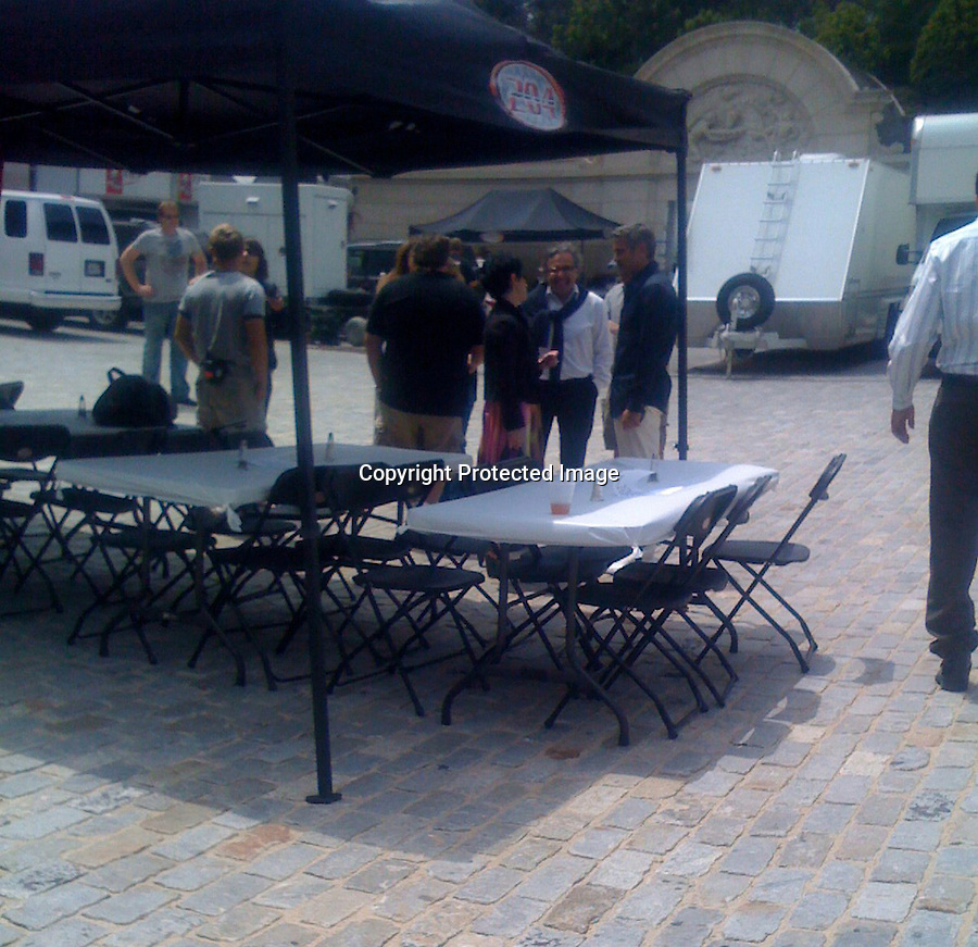 4-30-08   Exclusive.www.abilityfilms.com 805-427-3519.abilityfilms@yahoo.com. George Clooney on the set of a Martini and Rossi commercial.  The other leading character is actress Shannyn Sossamon.  The shoot was at a. mansion in Beverly Hills that belongs to the owner of Clear Channel and has been sponsored by Dolce and Gabbana, hence Clooney dressed in D & G. from head to toe. Notice the mustache on Clooney, a finely groomed pencil stasch.