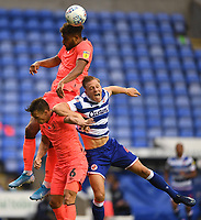7th July 2020; Madejski Stadium, Reading, Berkshire, England; English Championship Football, Reading versus Huddersfield; Steve Mounie of Huddersfield competes in the air with Michael Morrison of Reading
