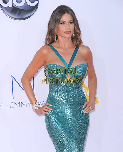 Sofia Vergara.The 64th Anual Primetime Emmy Awards held at Nokia Theatre L.A. Live in Los Angeles, California, USA..September 23rd, 2012   .emmys half length viagra blue green teal dress hands on hips dangling silver earrings sequins sequined bracelet cut out away.CAP/DVS.©DVS/Capital Pictures.