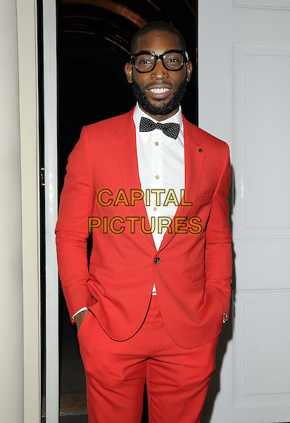 Tinie Tempah ( Patrick Chukwuemeka Okogwu ).The London Collections: Men GQ Dinner, Sketch bar & restaurant, Conduit St., London, England..January 9th, 2013.half length black bow tie red tuxedo white shirt glasses hands in pockets beard facial hair .CAP/CAN.©Can Nguyen/Capital Pictures.