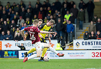 5th January 2020; Pirelli Stadium, Burton Upon Trent, Staffordshire, England; English FA Cup Football, Burton Albion versus Northampton Town; David Templeton of Burton Albion is tackled by Scott Wharton of Northampton Town  - Strictly Editorial Use Only. No use with unauthorized audio, video, data, fixture lists, club/league logos or 'live' services. Online in-match use limited to 120 images, no video emulation. No use in betting, games or single club/league/player publications
